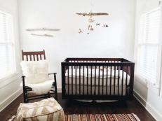 """For Elijah's nursery, we went with the smallest room in the house. This room is cozy and warm and has such soft light with a straight shot view of a giant Juniper tree just outside the window. Because the walls were white, I wanted the things in this room to be colorful and interesting to look at. There is no theme, simply things we love; handmade, hand me downs, items collected from travels & items that we already had in the home. The room is just the right balance of peaceful and playful."""